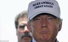 Donald Trump's white baseball cap, featuring his campaign slogan 'Make America Great Again...