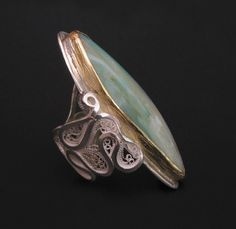 "Victoria Lansford  Riptide  Russian filigree and chased ring  22k gold, sterling, fine silver, Peruvian opal  1-7/8"" long x 1"" x 7/8"", size 7-1/2  © 2009,"
