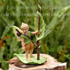 The River Elf This handsome little boy elf/fairy is wearing a leaf shirt, a quiver is slung over his shoulder, and he is balanced on his leaf boat, with a leaf sail! You could make a river of blue gl Clay Fairies, Fairies Garden, Gnome Garden, Male Fairy, Biscuit, Polymer Clay Fairy, Garden Crafts, Garden Ideas, Fairy Garden Accessories