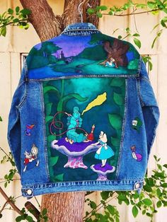 Custom hand painted Disney's Alice in Wonderland denim jacket with caterpillar smoking hookah, white rabbit, tea cup, drink me bottle and mad hatter hat on back and cheshire cat on front Painted Denim Jacket, Painted Jeans, Painted Clothes, Hand Painted, Diy Clothing, Custom Clothes, Diy Fashion, Ideias Fashion, Denim Art