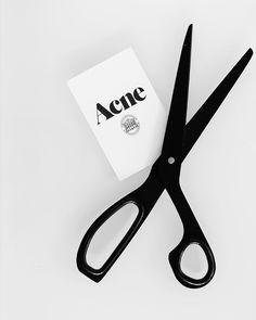 acne. black scissors.