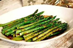 Perfectly roasted asparagus drizzled with a nutty browned butter sauce is an elegant side dish for steak or seafood and requires only 12 minutes baking time! Esparagus Recipes, Vegetable Recipes, Baking Recipes, Baked Asparagus, Grilled Asparagus Recipes, Steak Side Dishes, Brown Butter Sauce, Roast