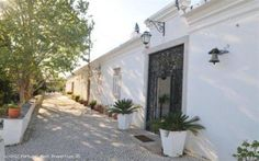 6 bedroom farmhouse with pool in São Brás de Alportel, Algarve, Portugal - Originally dating from 1888, this large and spacious recently renovated farm house is located close to the centre of the quiet town of Sao Bras de Alportel.  Just 20 minutes from Faro, the setting reveals the real essence of the old picturesque Algarvian architecture making this a very exquisite and unique property…