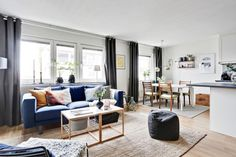 navy couches and grey curtains