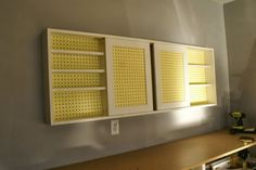 wall-mounted pegboard tool cabinet with sliding doors, tutorial featured on… Garage Wall Cabinets, Pegboard Garage, Pegboard Organization, Diy Garage Storage, Tool Storage, Storage Ideas, Organized Garage, Lumber Storage, Paper Storage