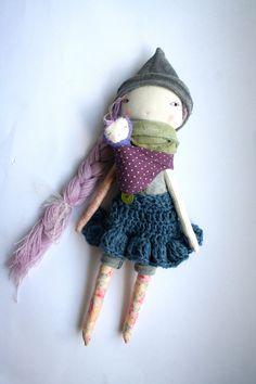 beautiful baby wearing mauve mama Lu doll 13ish rag by humbletoys.  love the baby!