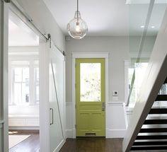 obsessed.  sliding white barn doors, lime green door, and glass pendant lighting.