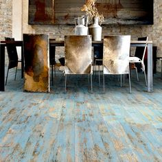 Prepare the floor by sanding the existing finish, whether it be to deglaze a varnish or sealer finish, or to smooth the finish. Thoroughly clean away the dust after sanding using a vacuum cleaner or slightly damp mop. Allow a wet floor to dry completely.