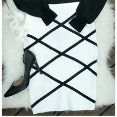 Black and white Bandage skirt Wow! This skirt flew off the racks, only one available in small. Gorgeous and form fitting bandage skirt in white with black strips detail. Spandex like Bebe bandage skirts Skirts Midi