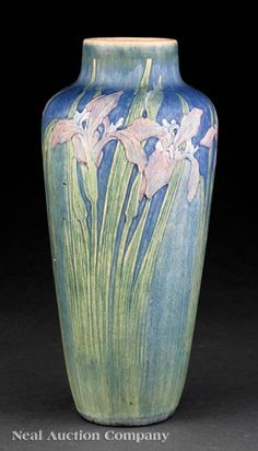 Newcomb College Art Pottery Vase, 1915, decorated by Alma Mason with Louisiana irises modeled in low relief, matte glaze with blue, green, pink and white underglaze