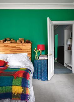 Bold green walls set the perfect backdrop to this guest room.