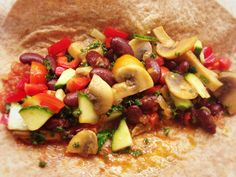 Vegan wraps with green kale mushrooms and kidney beans
