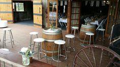 Barrels and bar stools for a barn wedding