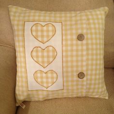 Handmade gingham cushion, with appliqué hearts, envelope opening fastened with two buttons