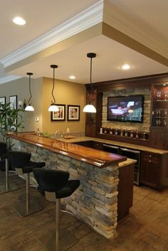 Love the lights and bar stools  I love the wood counter top - I would love to build a bar like this in our home