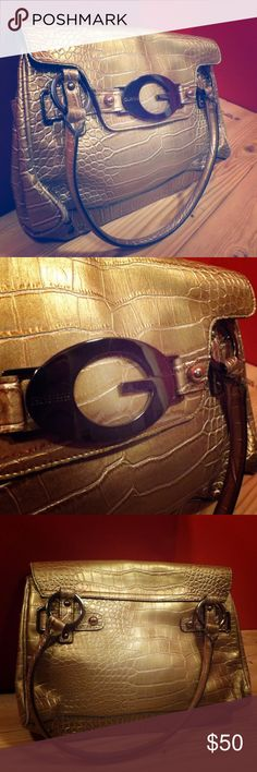 Guess Aligator Shoulder Purse Guess has been known for their widespread popularity and for good reason! This purse is lightly used and it shows! No imperfections means you can use this purse longer and have it looking new! The color equals matching won't be an issue and its a size that says confidence. Offers are welcomed!  Guess Bags