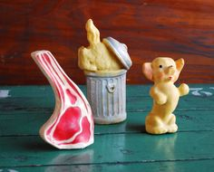 Dogs on a Bone, Steak, puppy & dog in trash can -  Vintage Squeeze - Squeak Toys. $19.00, via Etsy.