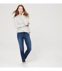 """In a mid indigo wash, our skinny jeans are mid-rise with a slim, streamlined fit from hip to hem. Your perfect fit if your waist is smaller, but your hips are curvier. Front zip with button closure. Belt loops. Five-pocket styling. Contrast topstitching. 30"""" inseam."""