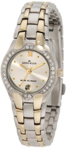 Anne Klein Women's 10-6927SVTT Two-Tone Swarovski Crystal Accented Watch Anne Klein. $40.09. Quartz Movement. Mineral crystal. Water-resistant to 99 feet (30 M). Stainless-steel case; Silver dial; Date function. Band Color: silver and gold. Save 47% Off!