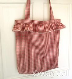 Style's in the bag with this pretty ruffled tote from Wag Doll