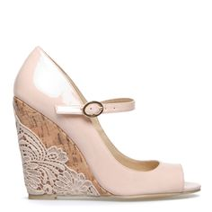 Not these shoes (they are ugly) but great idea if you find white shoes with cork on the bottom. Cover in lace.