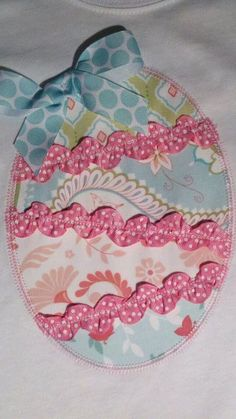Easter egg applique by ohhsooxford  Her designs are sooo different!