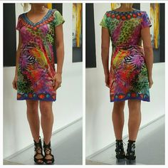 """""""Safari Glamour"""" Dress NWOT Brand new no tags  Bring out your wild side with this dress!! Multi colors/multi animal prints and jewel design make this dress a smashing success! Pair with sandals or heels.  No size tag, dress is a size small Material 55%Polyester 45%spandex (dress has stretch) Bust side to side approx 16.5"""" Length approx 33"""" Made in India BRAND Bondi Bondi             Dresses Mini"""