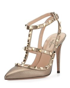 "Valentino tumbled metallic leather pump with signature Rockstud trim. 4"" covered heel. Pointed toe. T-strap vamp. Adjustable ankle and slingback straps. Leather lining and sole. Made in Italy."