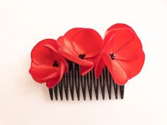 Poppy flowers hair comb red satin and black Swarovski rhinestones. €25.00, via Etsy.