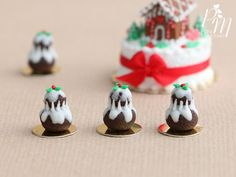 Christmas Miniature Food -  A seasonal version of the classic French religieuse pastry decorated like a Christmas pudding and topped with a