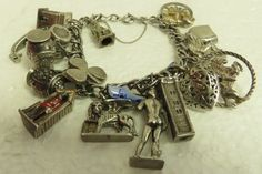 1950s traveler's sterling silver charm bracelet from davelovessugar2 https://www.etsy.com/listing/483352066/vintage-estate-silver-charm-double-chain?ga