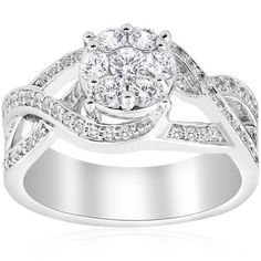 If you're shopping for and you want something that stands out, consider a crossover ring. These exquisite pieces feature delicately arranged bands that overlap and showcase an array of gorgeous diamonds. Round Solitaire Engagement Ring, Engagement Ring Cuts, Best Diamond Color, Diamond Cuts, Diamond Rings, White Gold Diamonds, Crossover Ring, Bands, Band