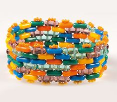 Free bead bracelet pattern using Preciosa Twin Roller--the two hole bead trend continues.