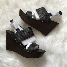 Charles David black & brown wedge Black woven straps. Brown wooden wedge. Studded design. Brand new in box. Offers welcome through offer tab. No trades. One small white flaw on top strap. Charles by charles david. Style: Isola. Charles David Shoes Wedges