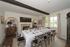 Fine dining: The separate dining room has commanding views over the surrounding fields...