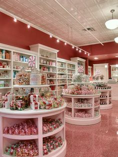 Confectionery Store-- love the white shelving against the pink walls.