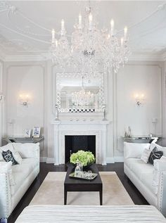 White, crystals & mirrors ... Lovely living room.