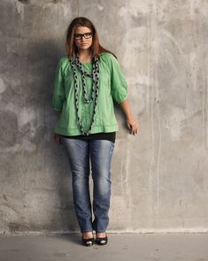 Plus size model Tara Lynn. I love this outfit -- the necklace - glasses, color, jeans! flat shoes and me running around an art studio.