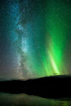 The Milky Way and the northern lights seem to merge over Finnmark, Norway, on September 25.    Auroras are created when charged solar particles collide with molecules in Earth's atmosphere, infusing the molecules with extra energy that then gets emitted as light.
