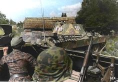 Soldiers in a SdKfz 251/1 halftrack watch cautiously as a Panther Ausf A tank comes in to provide some close support against a dangerous entrenched enemy postion.
