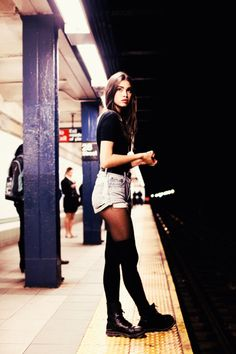 Jean shorts, tights, thigh high socks, Dr. Martens. Tight black tee. Can't go wrong.