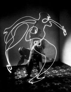 A light 'painting' by Pablo Picasso, using a moving light source and a slow shutter speed. France, 1949