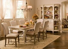 "A sophisticated take on traditional farmhouse style, this Fair Harbour 7-piece dining set boasts a charming two-toned table and beautiful linen-upholstered chairs. The table also includes a convenient 18"" extension leaf, so you'll have plenty of room for everyday meals and those special occasions when you need to seat a few more."