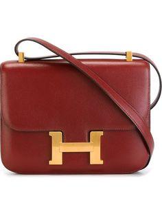 faddbb2a369 Hermès Vintage  The Constance  shoulder bag, shop at Farfetch Hermes Bags,  Hermes