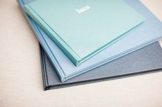 Buckram albums, from the bottom: Steel, Aquamarine, Mint