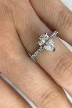 You can't go wrong with a pear engagement ring. Tap this pin to take a closer look at this diamond engagement ring and discover even more beautiful gold engagement rings you'll love. Pear Diamond Rings, Pear Diamond Engagement Ring, Elegant Engagement Rings, Beautiful Diamond Rings, Diamond Wedding Rings, White Gold Rings, Bridal Jewelry, Closer, Diamond Jewellery