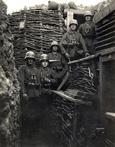 "ww1 • rare photo of the stirnpanzer ""brow-plate"" by drakegoodman. well equipped sentries from two unidentified units prepare to enter the line, each wearing a stirnpanzer affixed to the front of their m1916 stahlhelme. the stirnpanzer was a 4mm thick steel plate weighing about 4kg and designed to be mounted on the front of the steel helmet • late 1916 onwards"