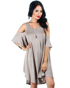 Mocha Lyss Loo Open Shoulder Over Sized Tunic Dress This adorable Tunic Dress is a must have in every women's closet. You will love the oversized look with the open shoulder-Sleeved look. This dress i