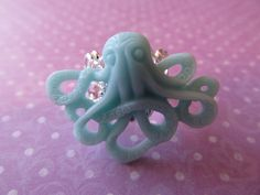 boy, do I not know what to make of this one. Aquamarine Octopus Ring.