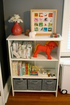 Nursery Bookcase Styling Ideas - we love bins at the bottom to hide/store toys!